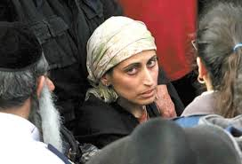 Avivit Se'ar at the funeral for her deceased husband and 5 children