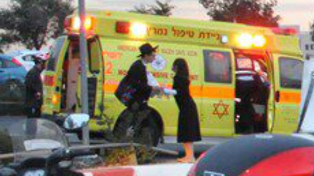 Shmuel and Chana Braun at the site of the terror attack 10 months ago