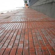 A Brick Wall, 8 Stories High