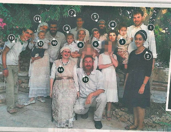 The whole Glick family: including children, sons and daughters-in-law, and grandchildren.