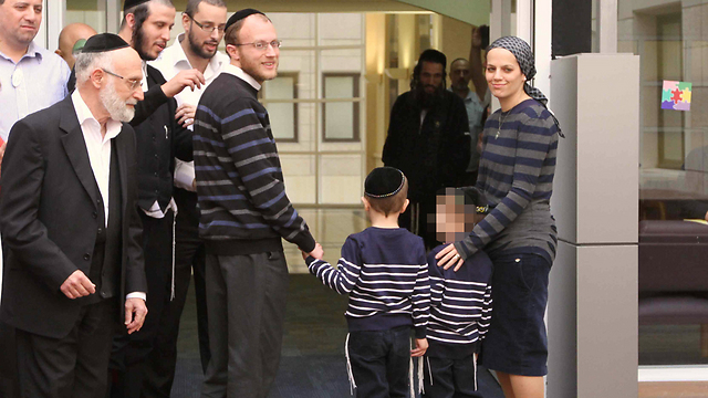 The Gross family leaving the hospital today. (Photo by Ido Erez)