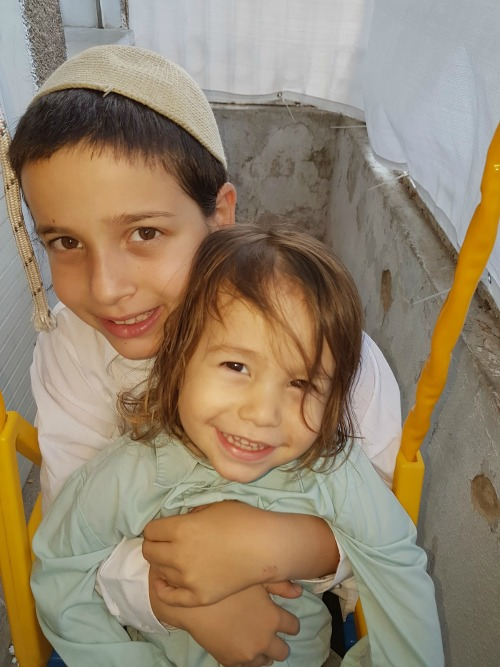 Milka's sons, Yehoyada Yechiel (the older son) and Yoshiyahu Meir, named after Rebbe Yechiel Meir.