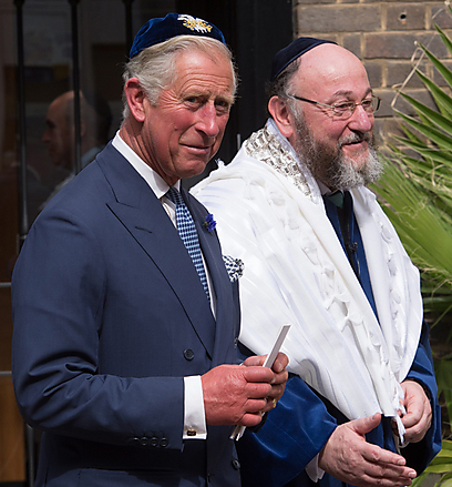 Prince Charles wears a kippah at the ceremony celebrating the new chief rabbi of the UK, Rabbi Ephraim Mervis.