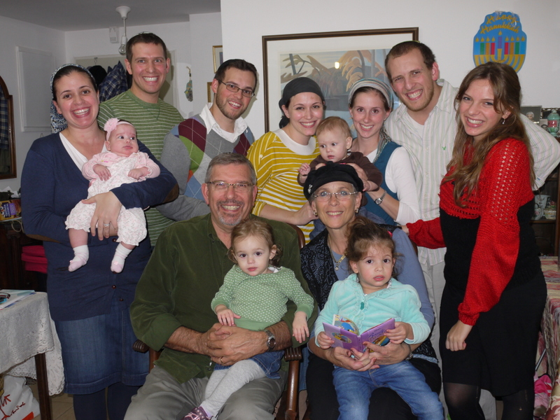 A recent photo of Marci and her husband with their children, their children's spouses, and grandchildren.