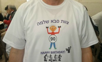 The shirt reads: Saba Shlomo Staff, Happy 90th Birthday!