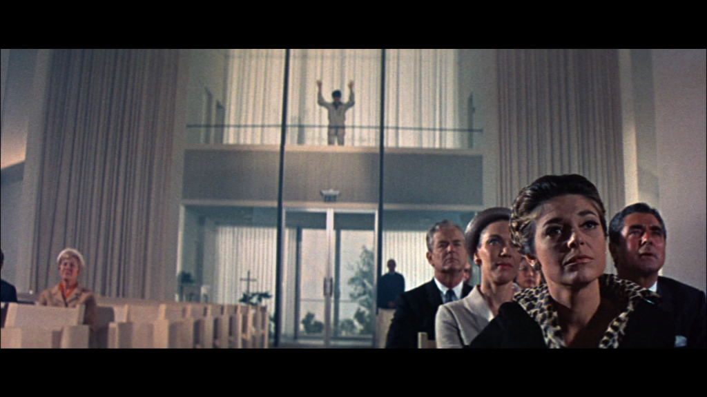 Dustin Hoffman interrupting Elaine's wedding in the final scene of The Graduate.